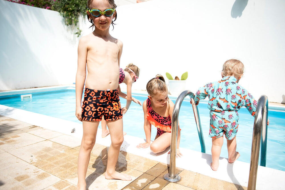 kids playing at the pool, boy wearing swim shorts