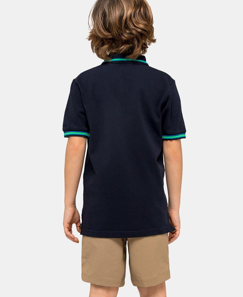 boy wearing a blue polo shirt