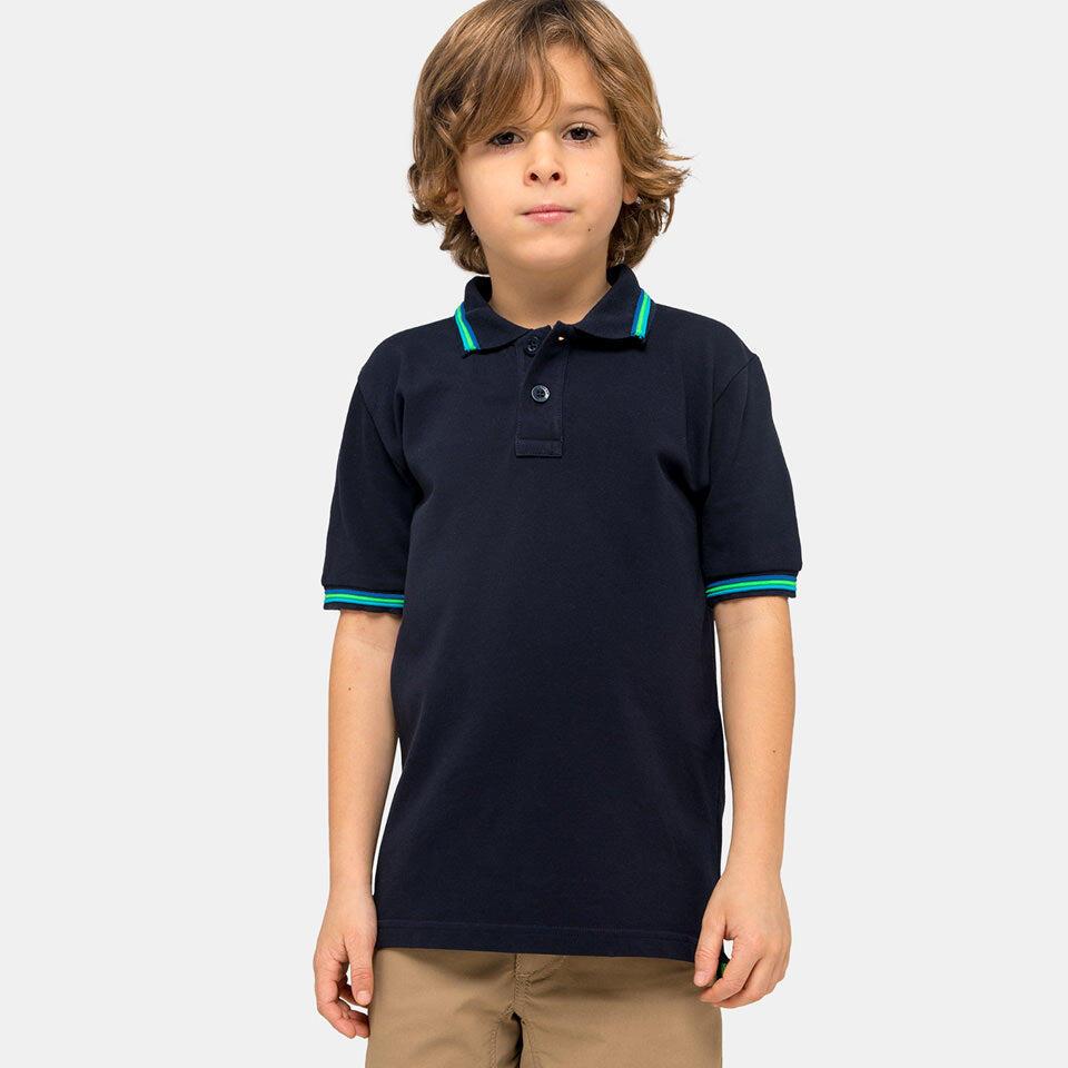 boy wearing a navy blue polo shirt