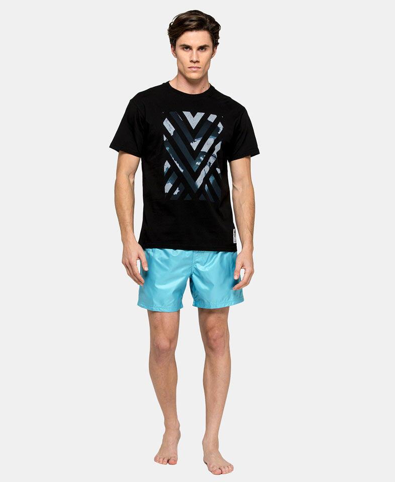 man wearing a mens designer graphic t shirts