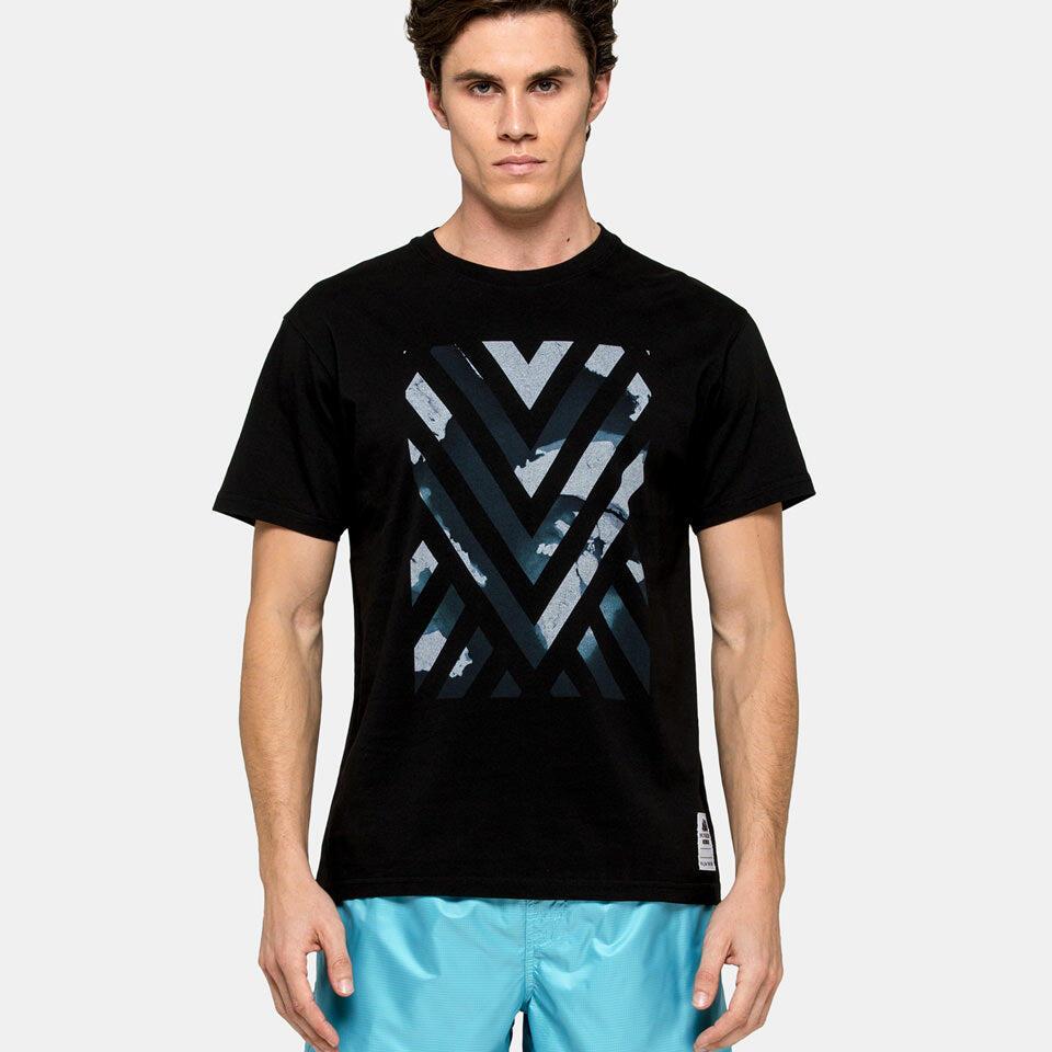 man wearing a black graphic t shirt