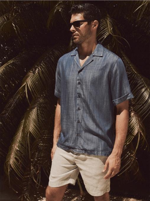 man wearing a navy blue tencel shirt