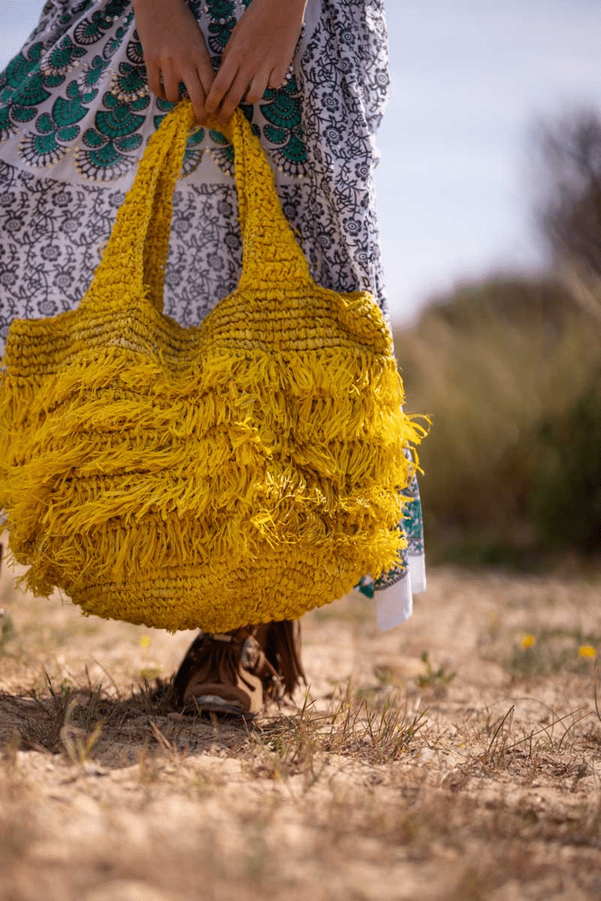 woman carrying a Hippie Bag in Yellow